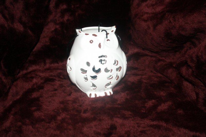 17. Owl tea light figurine