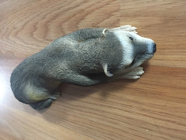 110. Ferret figurine laying
