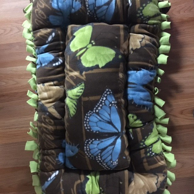 323. Brown bed w/butterfly
