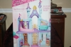 212. Disney princess doll house